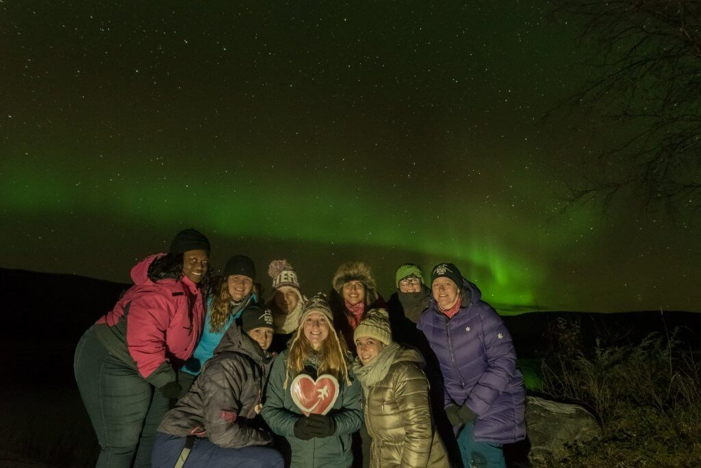 Group of guests at Aurora Holidays during their trip to Utsjoki under the northern lights