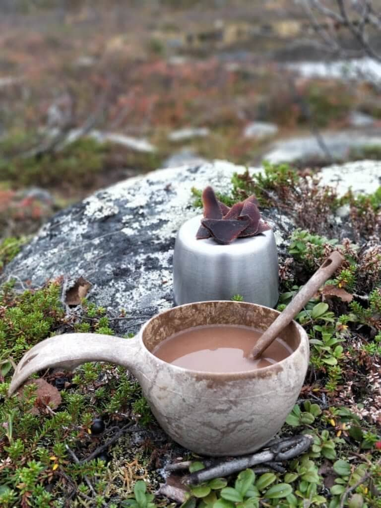 Coffee cup and local dried reindeer meat