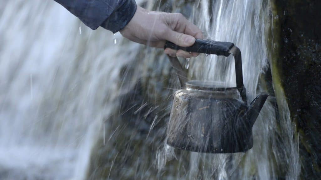 Waterfall filling a water can
